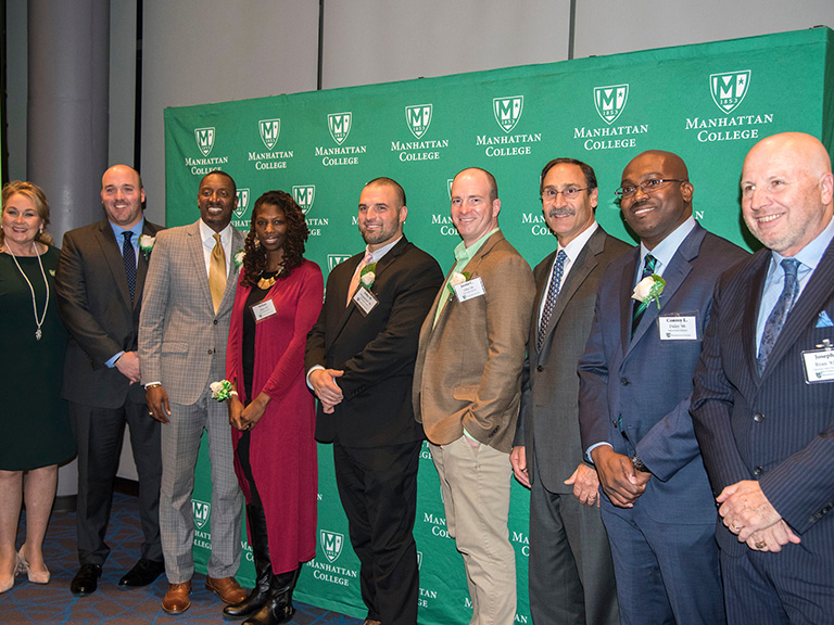 Athletics Hall of Fame class of 2018 in front of Manhattan College banner