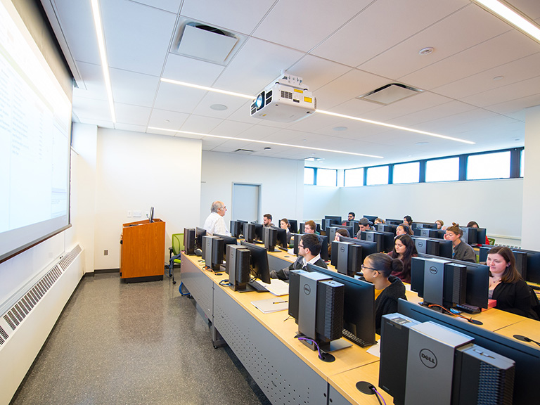 Photograph of LEO Chemical Engineering Computer Lab with students in class behind computers.