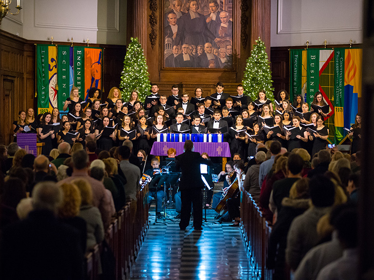 Manhattan College singers performing at Lessons and Carols