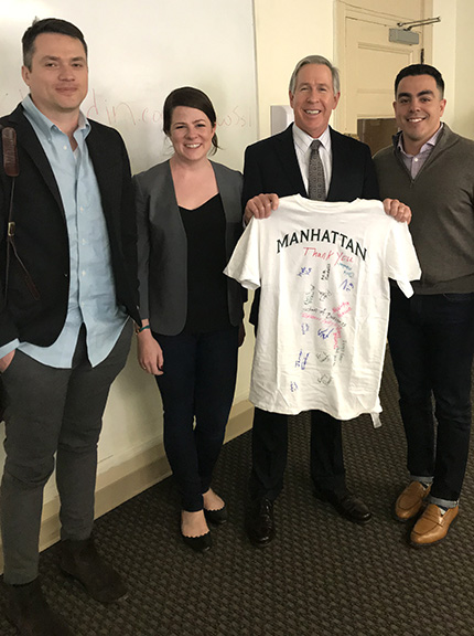 Manhattan College faculty giving Microsoft team a commemorative T-shirt