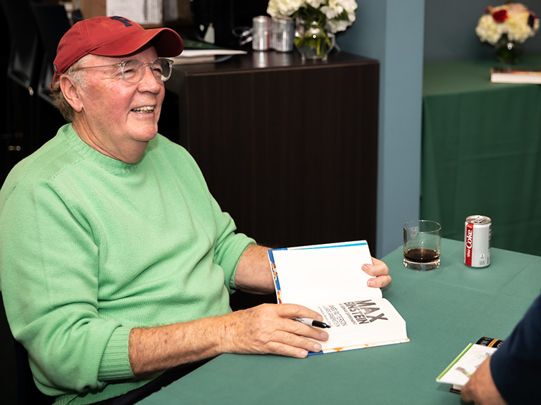 James Patterson smiling during a book signing