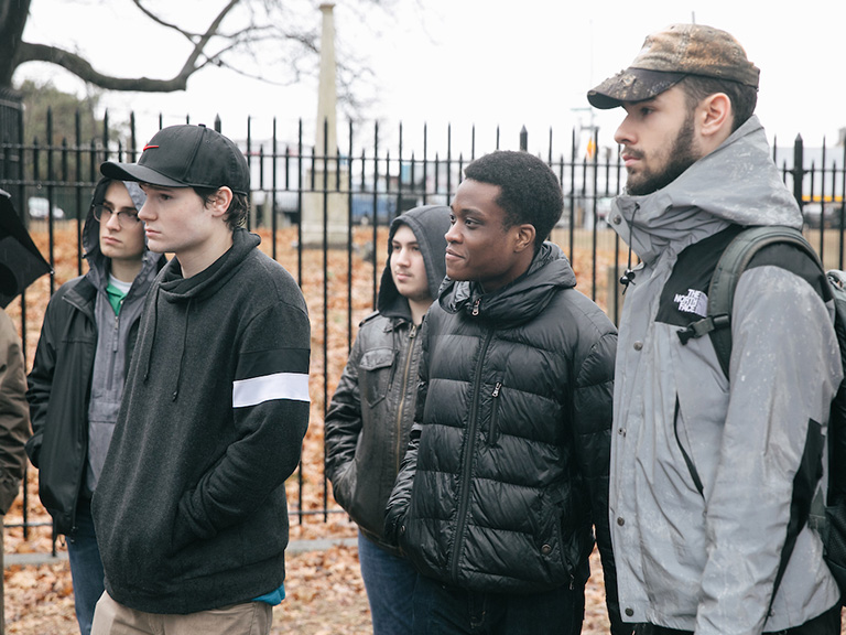 John Perez and other students stand in Drake Park
