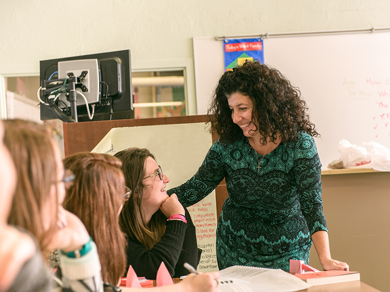 Lisa Rizopoulos with students in classroom