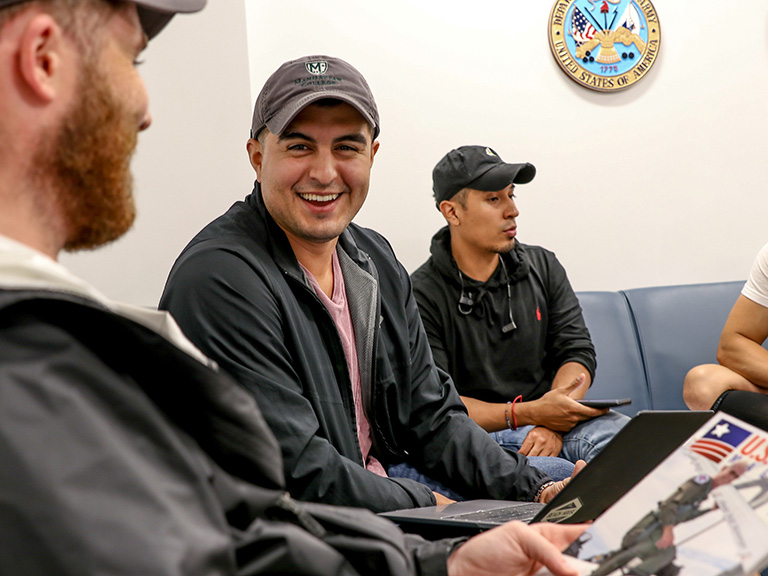 Student veterans laughing and talking in Veterans Success Center