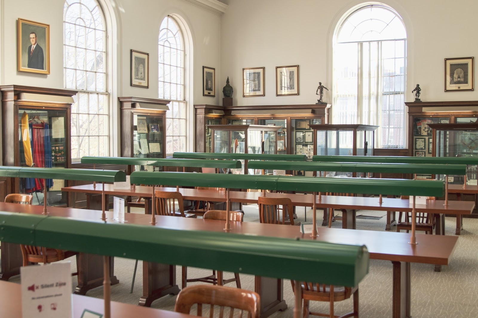 Library with wooden tables and wooden chairs