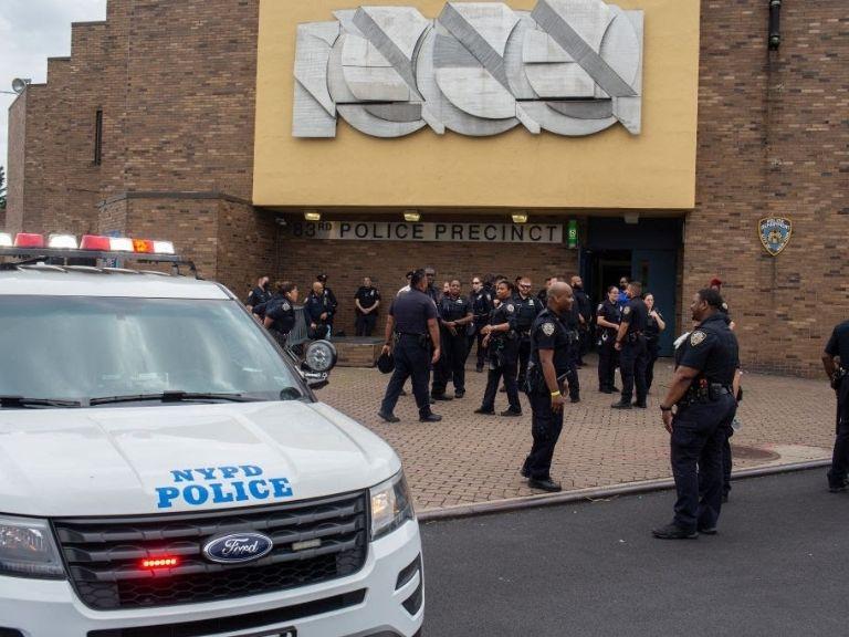 police department van in front of precinct