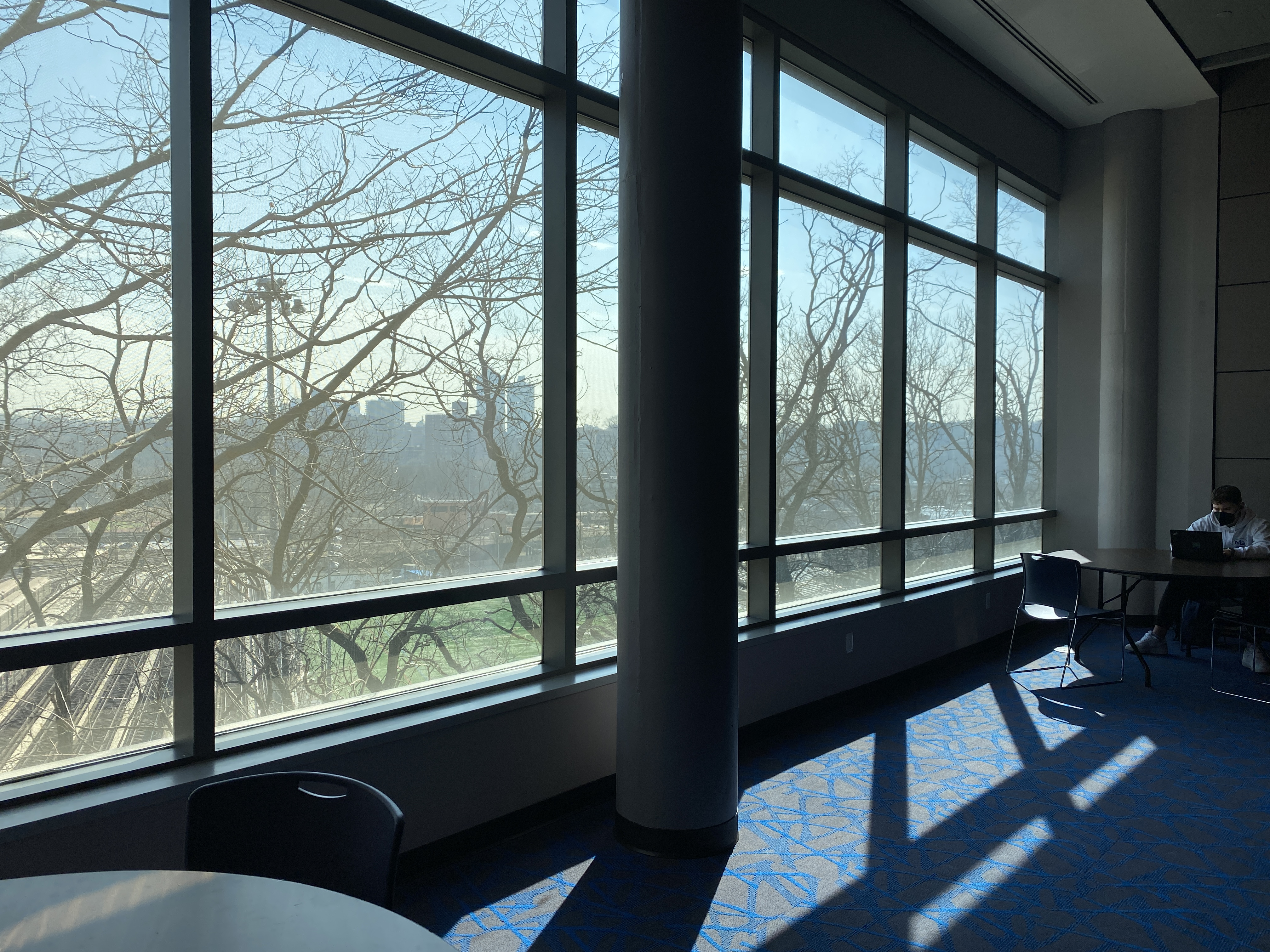 Room with big clear windows and tables for studying