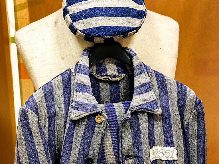 Concentration camp uniform hanging in O'Malley Library