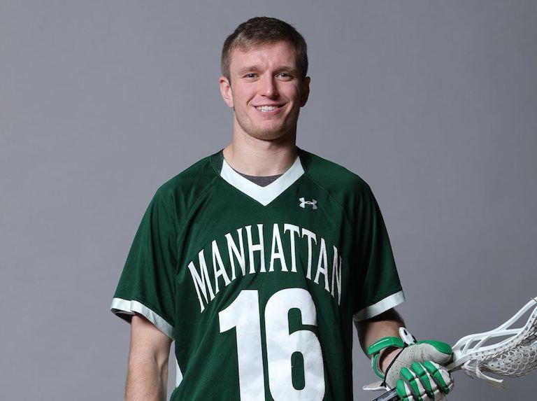 Luke Hanson holding a lacrosse stick