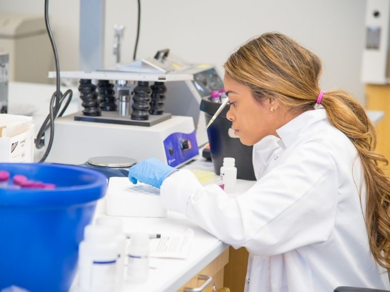 Manhattan College female student in lab