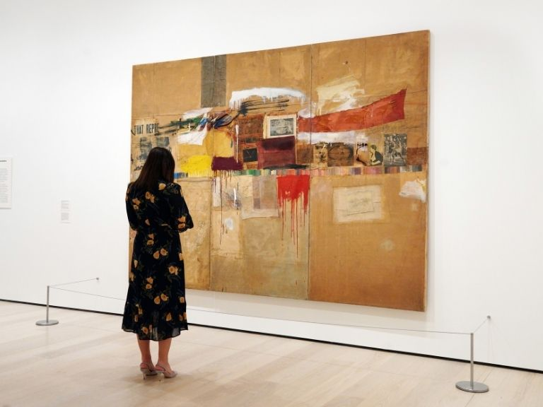 woman viewing painting in museum