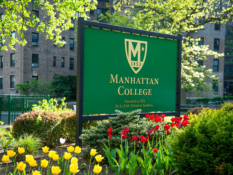image of green manhattan college sign during springtime