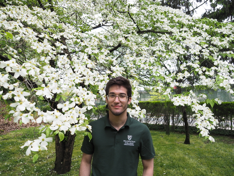 Male student in front of flowers.