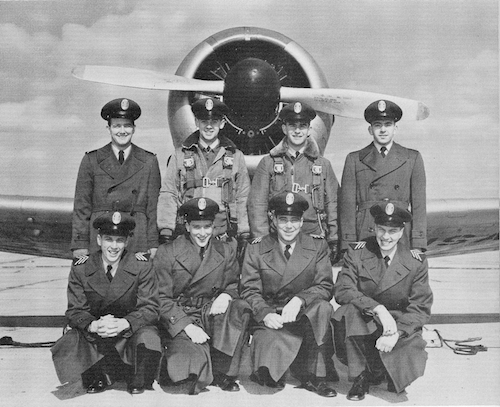 group of cadets posed in front of an airplane in 1952