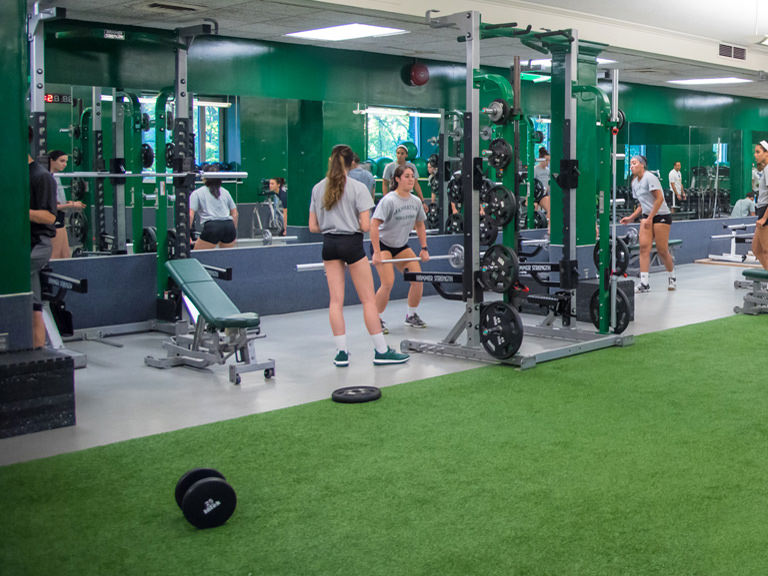 Students strengthen and tone on equipment in the fitness center.